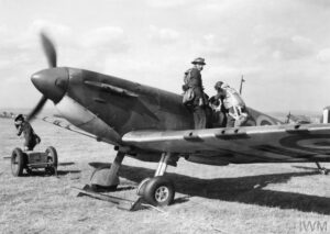 The CO of No. 66 Squadron, Sqn Ldr Rupert Leigh, climbs into his Spitfire Mk I, R6800 LZ-N, at Gravesend, September 1940.
