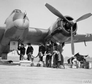 ristol Beaufighter Mk VIF of No. 96 Squadron RAF being re-armed at Honily, Warwickshire, 23 March 1943.