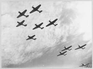 THE BATTLE OF BRITAIN 1940 Operations: Nine Hawker Hurricanes of 85 Squadron, Royal Air Force seen from slightly below.
