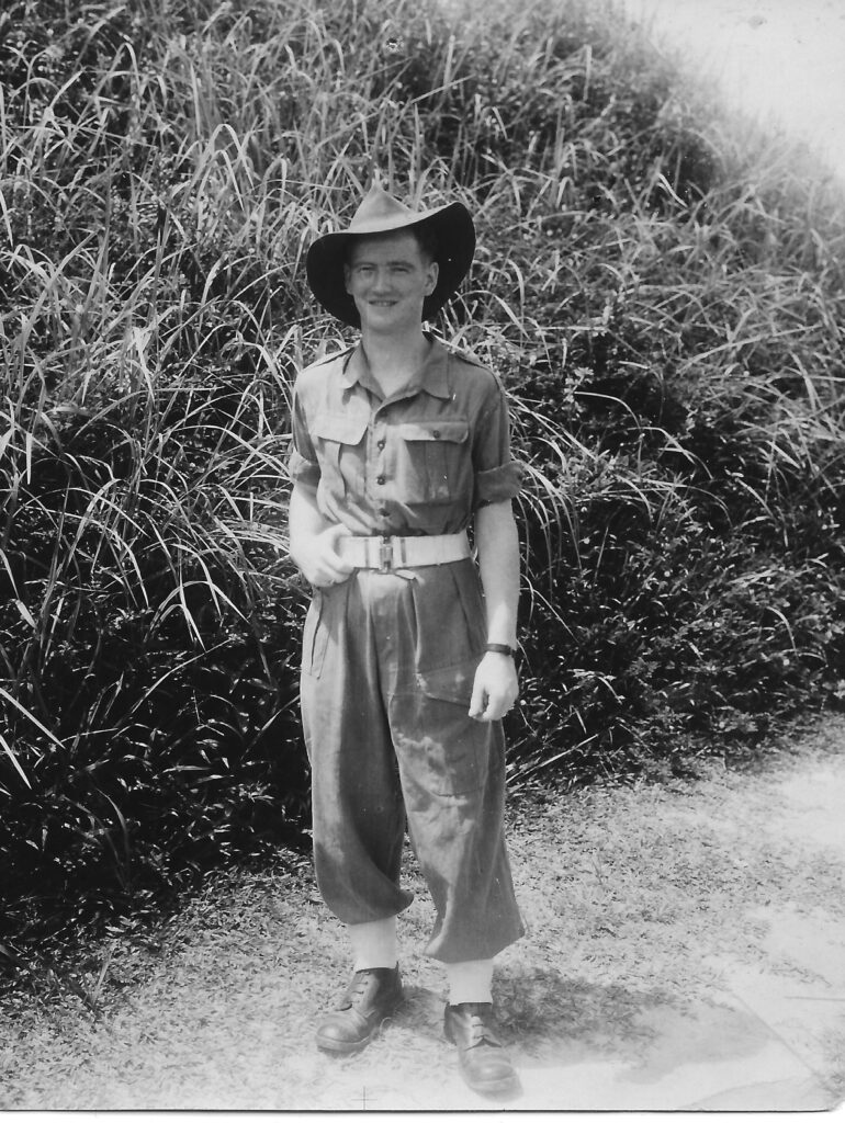 Photograph of Jim in Burma 1944 wearing standard army uniform ( pattern 40? ), not tropical gear, but large brimmed floppy hat.