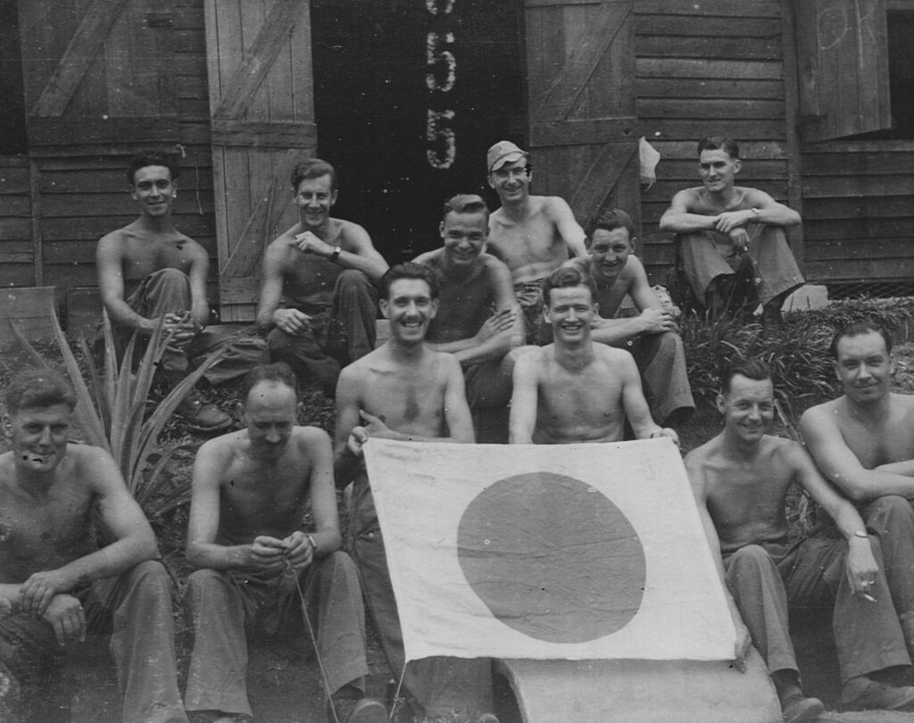 With Japanese Flag taken from crashed aircraft Burma 1944 Jim is holding bottom right corner